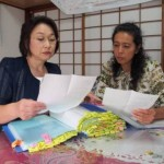 Facing reality: National HPV Vaccine Victims Network Association founders Toshie Ikeda (left) and Mika Matsufuji look through victims' case files in Tokyo in September. | MASAMI ITO